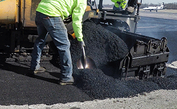 Asphalt being poured to be