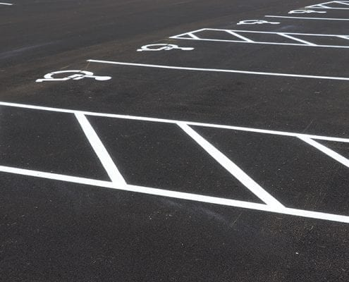 Handicapped parking spaced paved, marked, and striped by Libs Paving