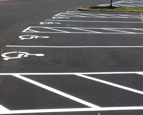 Close up of handicapped parking spots paved, striped, and detailed by Libs Paving