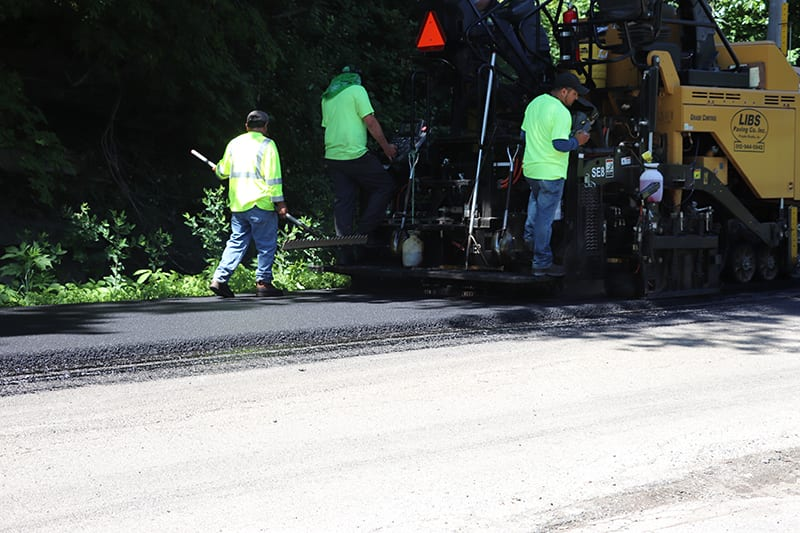 Construction workers at a Libs Paving Co project