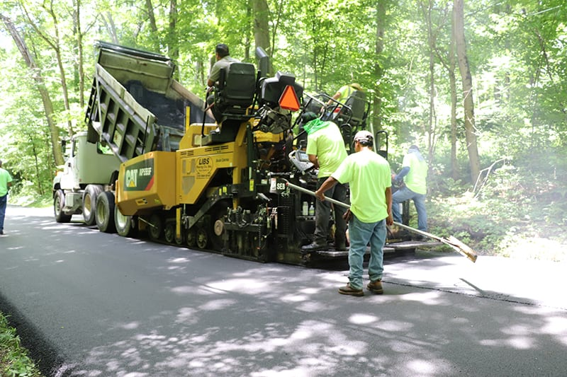 Construction workers working on an an asphalt paving project