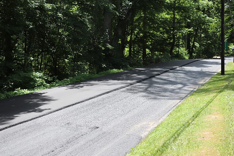 Asphalt road being paved by Libs Paving Co