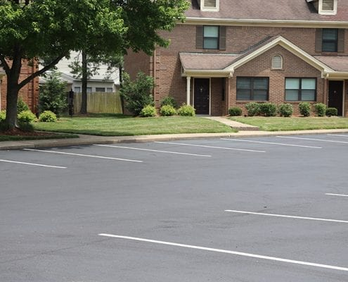 Newly paved asphalt parking lot in a residential area