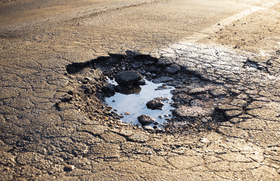 we specialize in Pothole repair at Libs Paving co as well as commercial paving services.