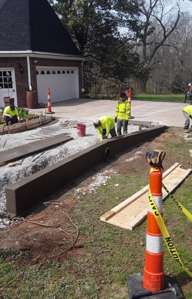 Libs Paving company hard at work creating concrete curbing for a residential neighborhood.